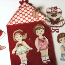 Fabric paper dolls with Christmas clothes and accessories