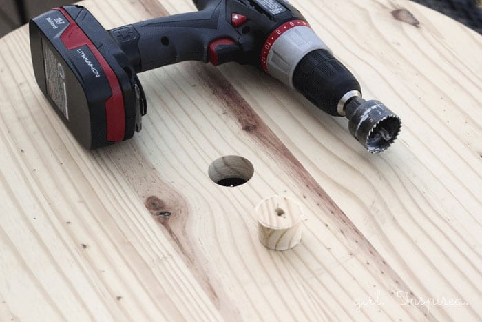 drill on unfinished wooden round with hole drilled out in center