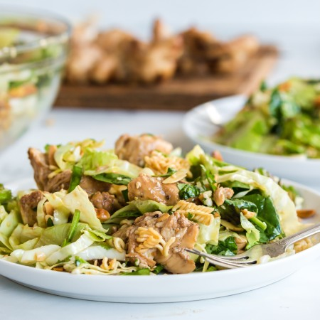white plates with Chinese chicken salad