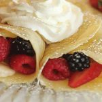 Crepes with Berries and Bananas inside and whipped cream