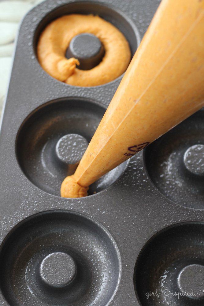 Use piping bag to add batter to donut pan.