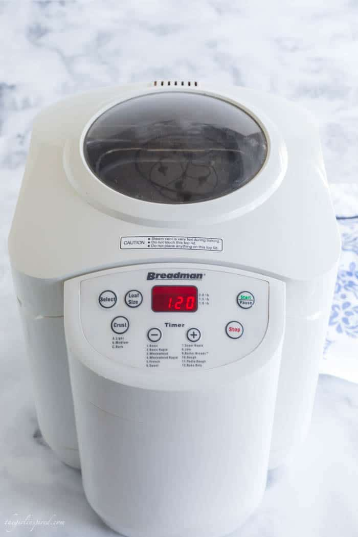 white bread machine on marble countertop