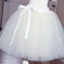 White tutu with white ribbon on dress form
