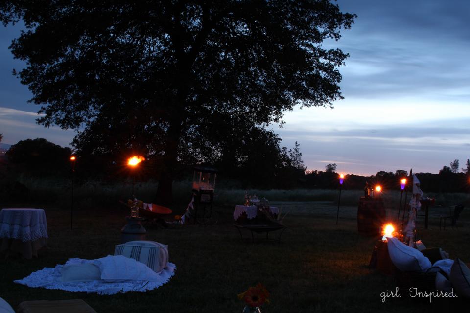 Tiki Torches glow at Outdoor Movie Night