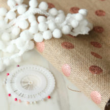 Make this festive Pom Pom Tablecloth in a matter of minutes!
