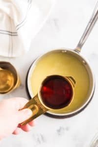 rum in measuring cup over saucepan with glaze
