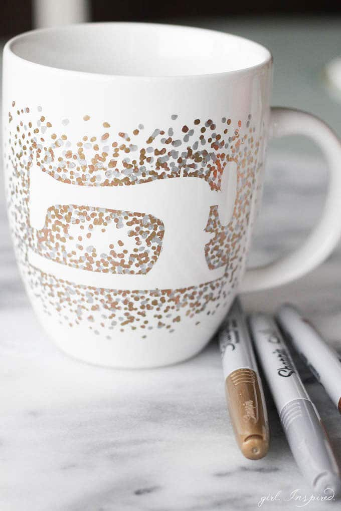 Create a sewing machine image on a mug with metallic Sharpie markers.