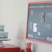 "red framed chalkboard with ""menu"" stencils"