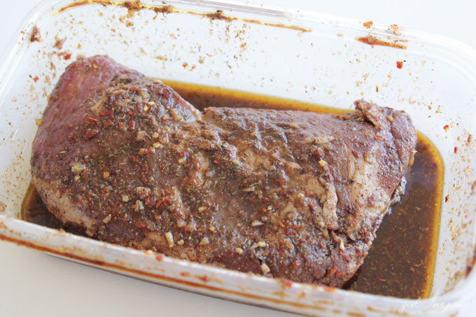 tri tip roast in marinade in glass baking dish
