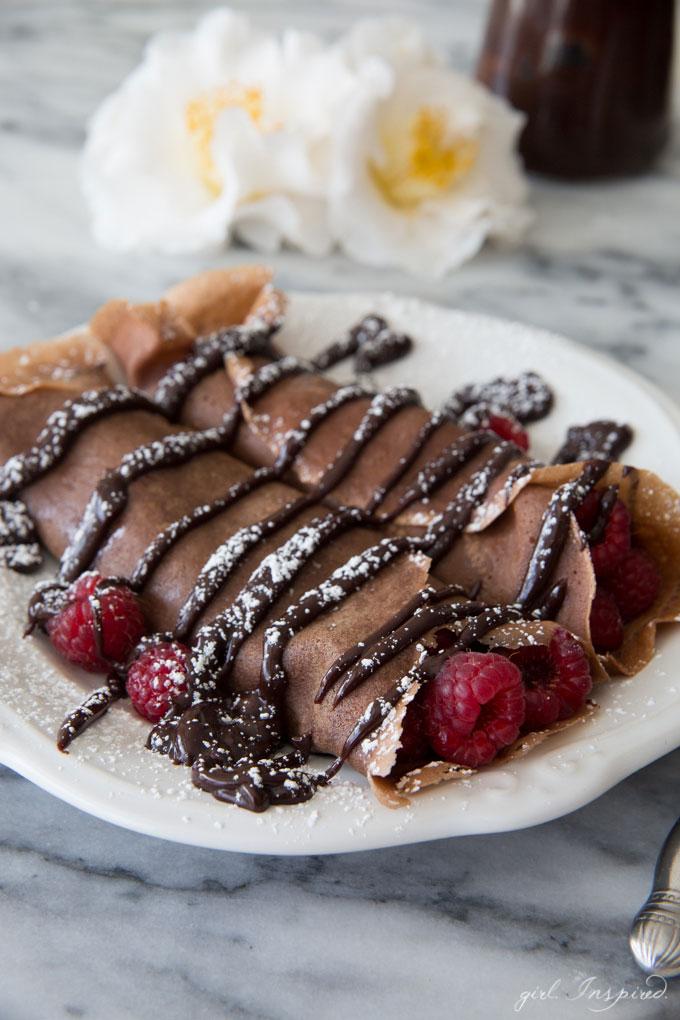 Chocolate Raspberry Crepes - These indulgent crepes are made with a chocolate batter and filled with fresh raspberries and doused with rich, chocolate ganache. YUM!