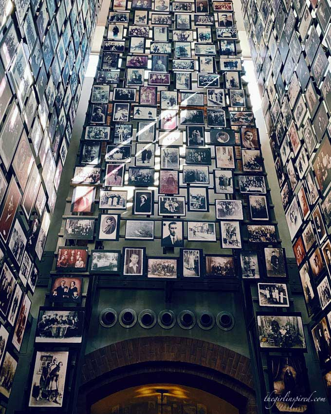 Upward view of hallway filled with photographs