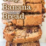 sliced chocolate chip banana bread on marble counter with walnuts, chocolate chips, banana peel, with text overlay