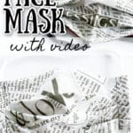 finished serged newsprint fabric mask on white background with text overlay
