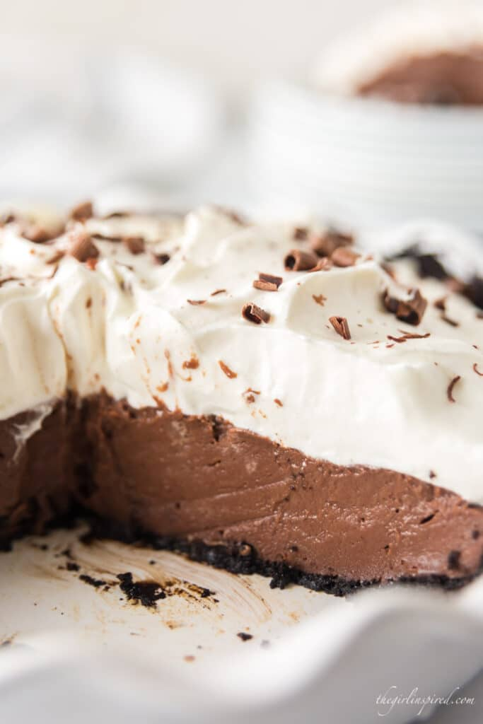 closeup of chocolate pie and whipped cream layers inside white pie plate