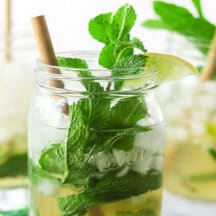 mint leaves and bamboo straw in mason jar mojito