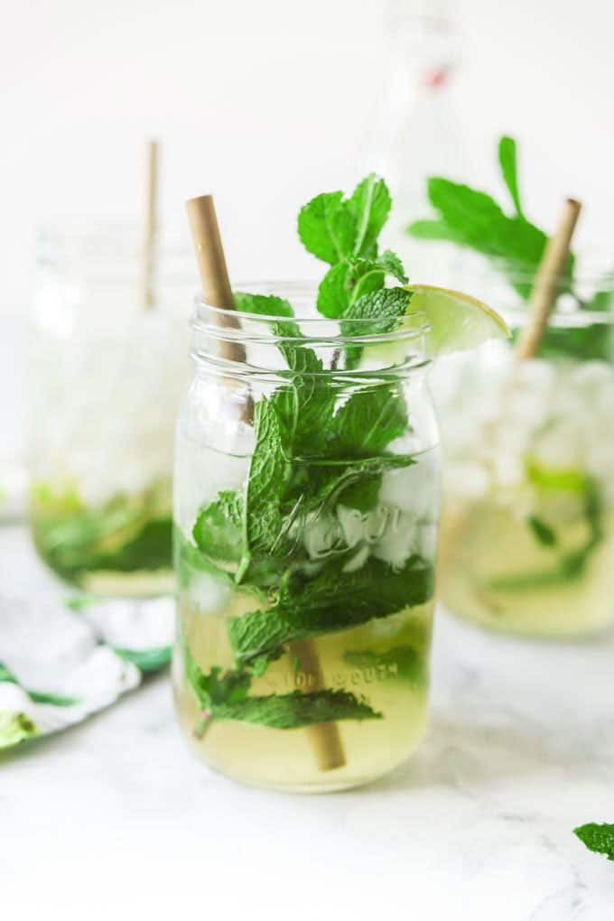 classic rum mojito with mint and lime in mason jars
