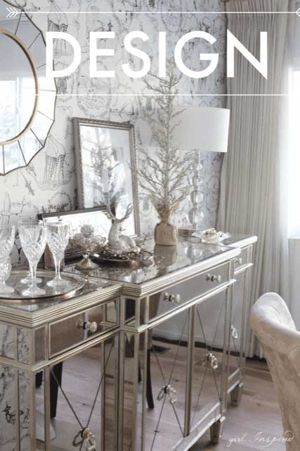 living room with mirrored buffet, mirrors, crystal glasses, silver lamp, silver tree