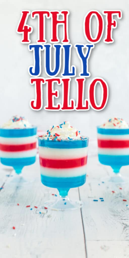 red white and blue jello layered in plastic footed cups with whipped cream and sprinkles and text overlay