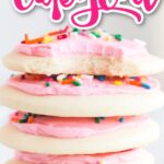 stack of lofthouse cookies with pink frosting and sprinkles on three white plates with bite taken out of the top cookie and text overlay