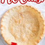 baked oil pie crust set on white towel with text overlay