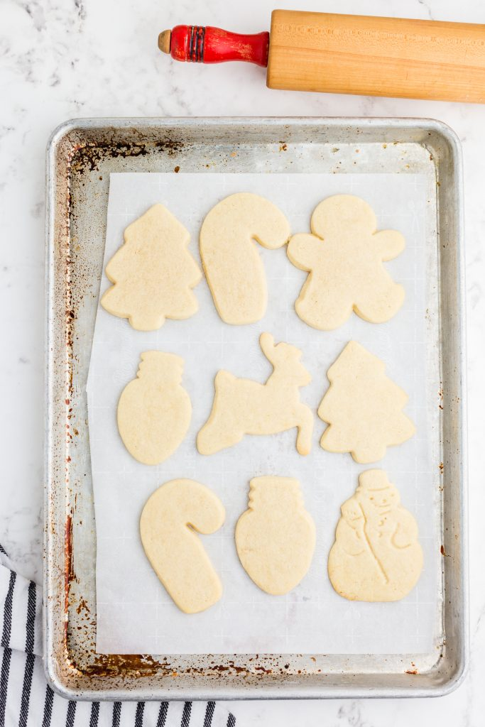 Christmas cut out cookies baked on cookie sheet