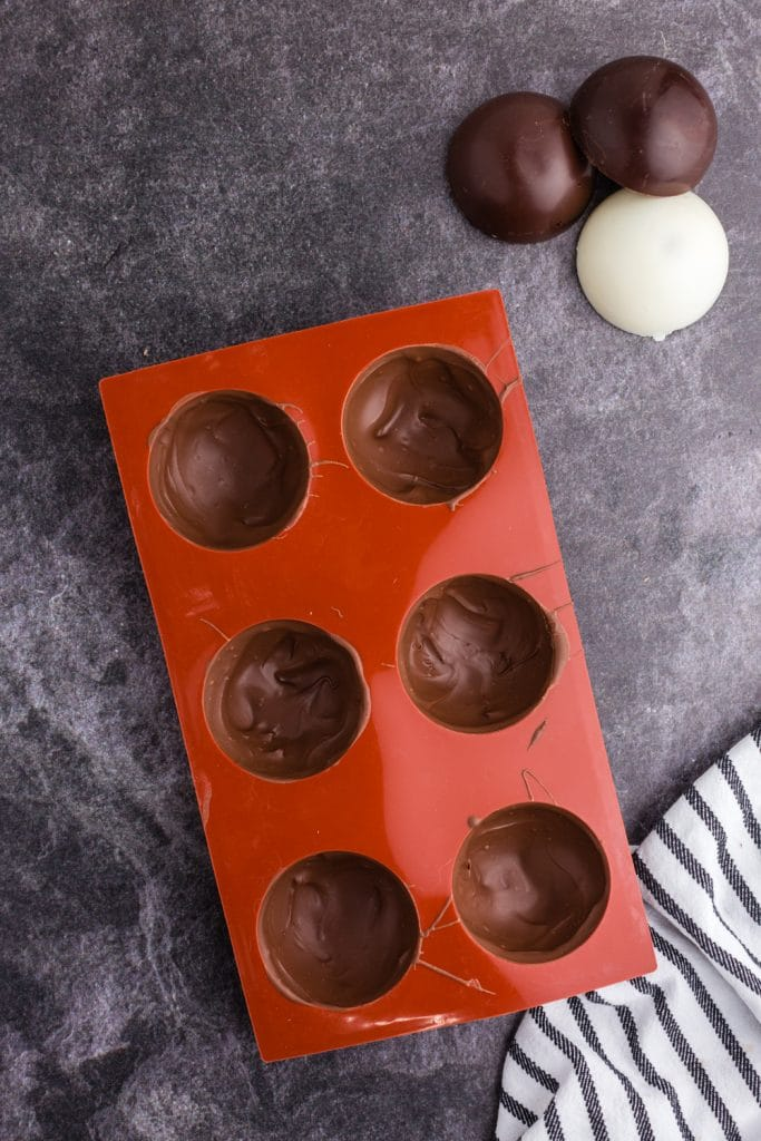 hardened chocolate in sphere molds