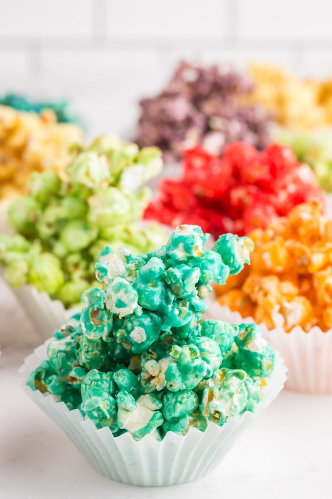 cupcake liner cups filled with different colors of popcorn