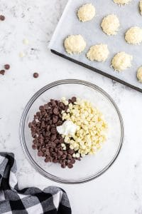 white and milk chocolate chips with shortening in glass mixing bowl