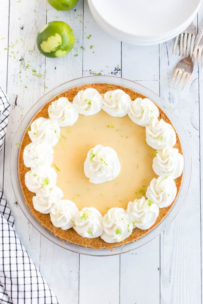 key lime pie with whipped cream piped on top