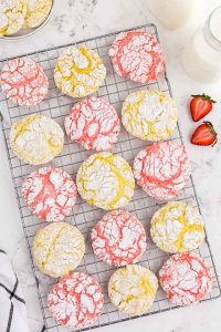 overhead of pink and yellow crinkle cookies on cookie sheet